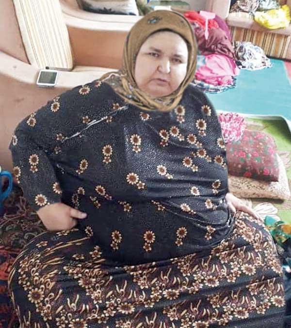 عکس خبري -دردسرهاي دفن زن 350 کيلويي (+عکس)
