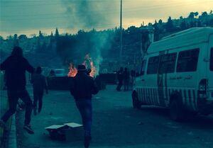 عکس خبري -درگيري فلسطينيان و نظاميان صهيونيست در مرکز بازجويي اسراي فلسطيني/ زخمي شدن ?? نفر در درگيريهاي نابلس